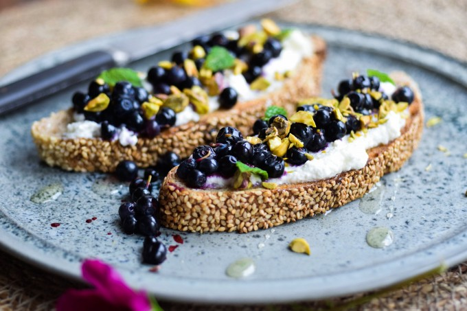 Ricotta toast with wild blueberries is a healthy breakfast