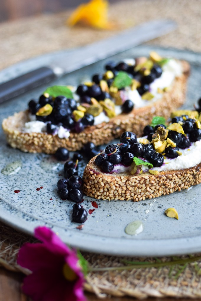 Nordic Ricotta toast with wild blueberries and pistachios